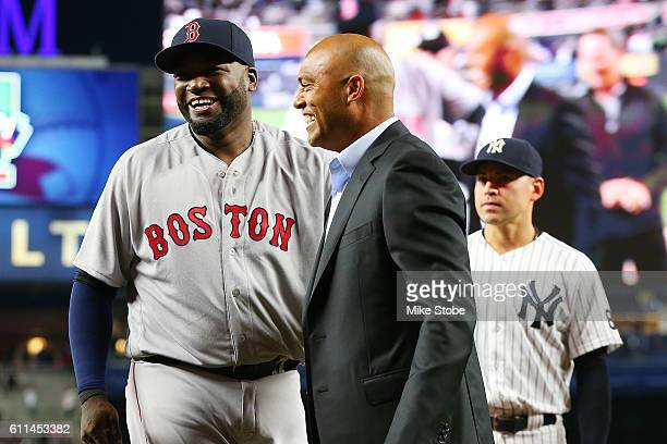 David Ortiz of the Boston Red Sox and Former Yankee Mariano Rivera share a laugh during a pregae ceremony to honor David Ortiz at Yankee Stadium on...