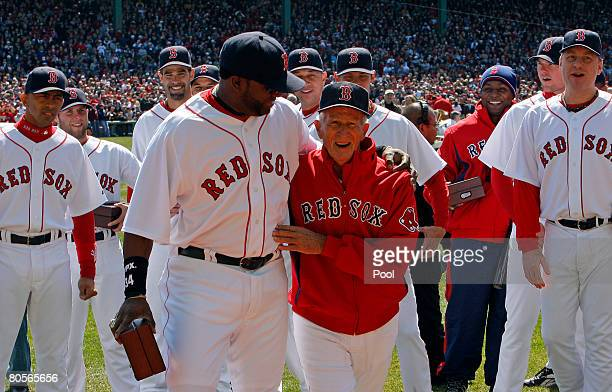 David Ortiz of the Boston Red Sox and Red Sox legend Johnny Pesky walk to center field to raise the 2007 World Series banner during pregame...