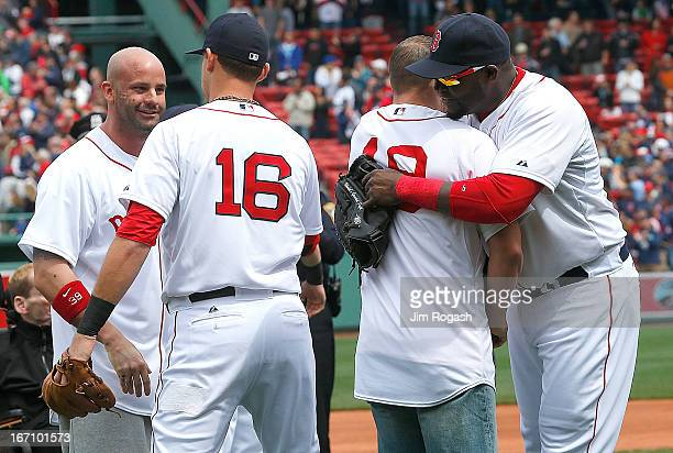 David Ortiz of the Boston Red Sox and Will Middlebrooks of the Boston Red Sox shake hands Matt Paterson who aided victims and Steven Byrne who was...