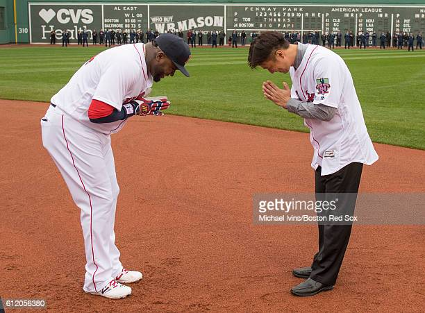 David Ortiz of the Boston Red Sox bows to former teammate Hideki Okajima during a ceremony honoring him before his final regular season game on...