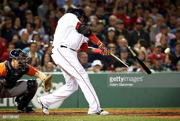 David Ortiz of the Boston Red Sox breaks his bat in the eighth inning during the game against the Houston Astros at Fenway Park on May 12 2016 in...