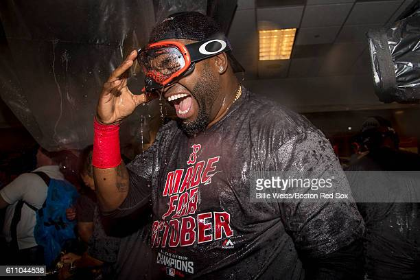 David Ortiz of the Boston Red Sox celebrates after clinching the American League East Division after a game against the New York Yankees on September...