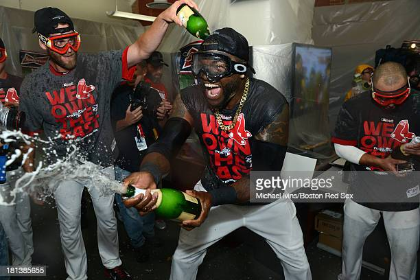 David Ortiz of the Boston Red Sox celebrates after defeating the Toronto Blue Jays and clinching the American League East on September 20 2013 at...