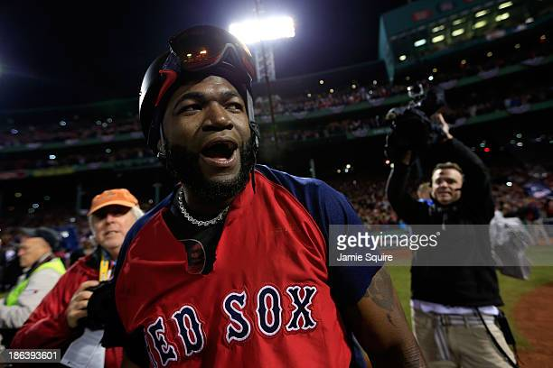 David Ortiz of the Boston Red Sox celebrates after defeating the St Louis Cardinals 61 in Game Six of the 2013 World Series at Fenway Park on October...