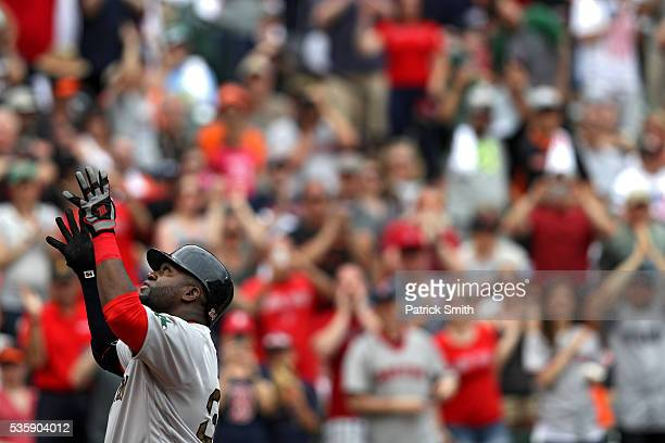 David Ortiz of the Boston Red Sox celebrates after hitting a home run against the Baltimore Orioles during the eighth inning at Oriole Park at Camden...