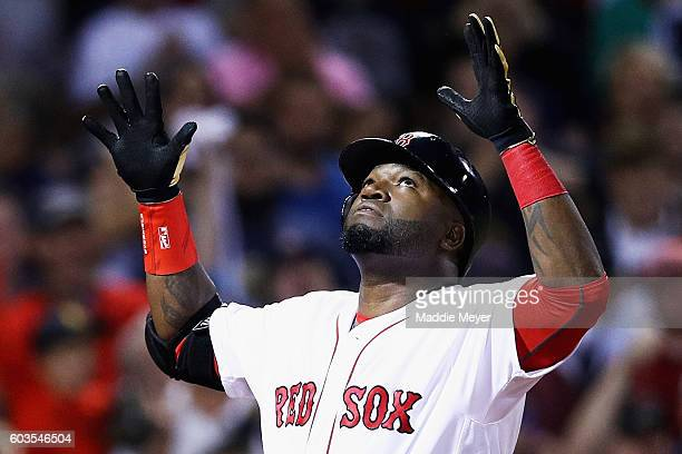 David Ortiz of the Boston Red Sox celebrates after hitting a home run against the Baltimore Orioles during the sixth inning at Fenway Park on...