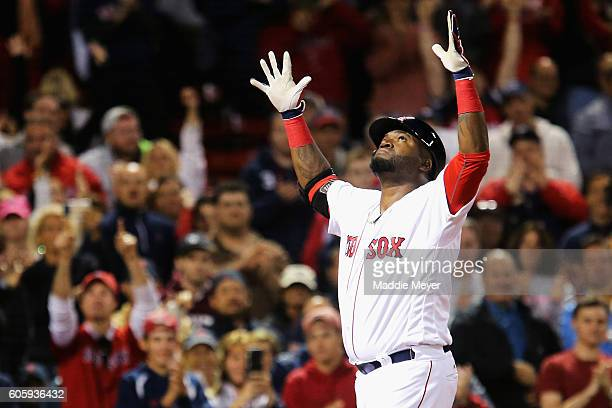 David Ortiz of the Boston Red Sox celebrates after hitting a home run against the New York Yankees during the eighth inning at Fenway Park on...
