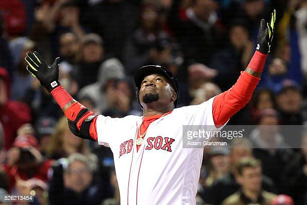 David Ortiz of the Boston Red Sox celebrates after hitting a two-run home run in the eighth inning during the game against the New York Yankees at...