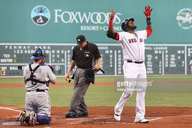 David Ortiz of the Boston Red Sox celebrates after hitting a tworun home run in the first inning during the game against the Texas Rangers at Fenway...