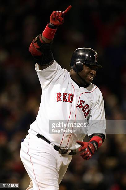David Ortiz of the Boston Red Sox celebrates after hitting the game winning RBI single in the fourteenth inning to defeat the New York Yankees 54...