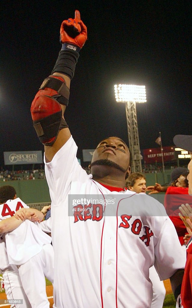David Ortiz #34 of the Boston Red Sox celebrates after hitting the game-winning home run to defeat the Anaheim Angels 8-6 in the 10th inning of Game 3 of the American League Division Series October 8, 2004 at Fenway Park in Boston, Massachusetts. The Red Sox swept the best-of-five series.