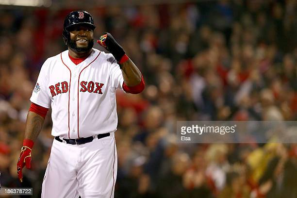 David Ortiz of the Boston Red Sox celebrates after scoring in the third inning against the St Louis Cardinals during Game Six of the 2013 World...