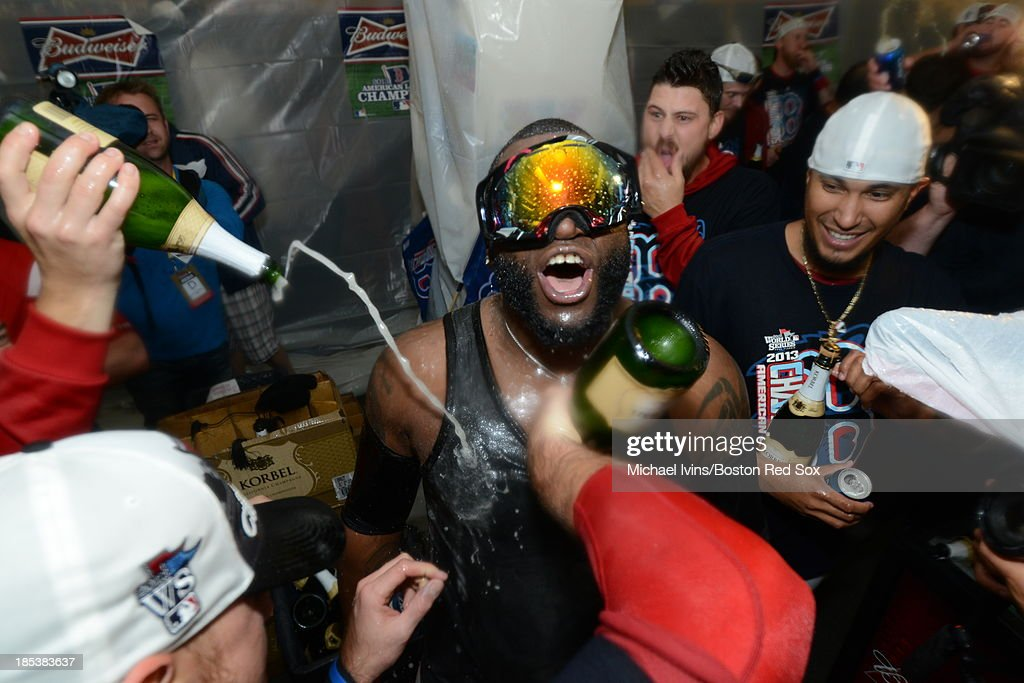 David Ortiz #34 of the Boston Red Sox celebrates in the locker room after defeating the Detroit Tigers and winning the American League Championship Series on October 19, 2013 at Fenway Park in Boston, Massachusetts.