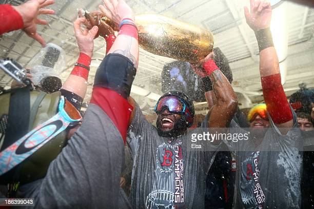 David Ortiz of the Boston Red Sox celebrates in the locker room after defeating the St Louis Cardinals 61 in Game Six of the 2013 World Series at...