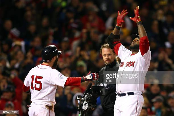 David Ortiz of the Boston Red Sox celebrates with Dustin Pedroia after hitting a two run home run in the sixth inning against the St Louis Cardinals...