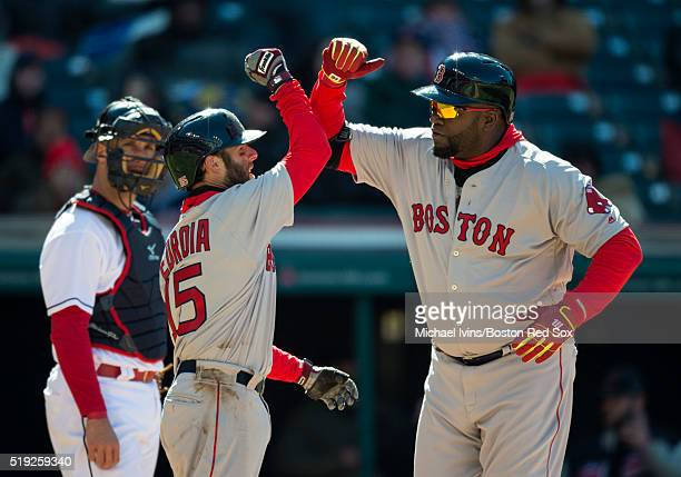 David Ortiz of the Boston Red Sox celebrates with Dustin Pedroia after hitting a tworun home run against the Cleveland Indians in the ninth inning on...
