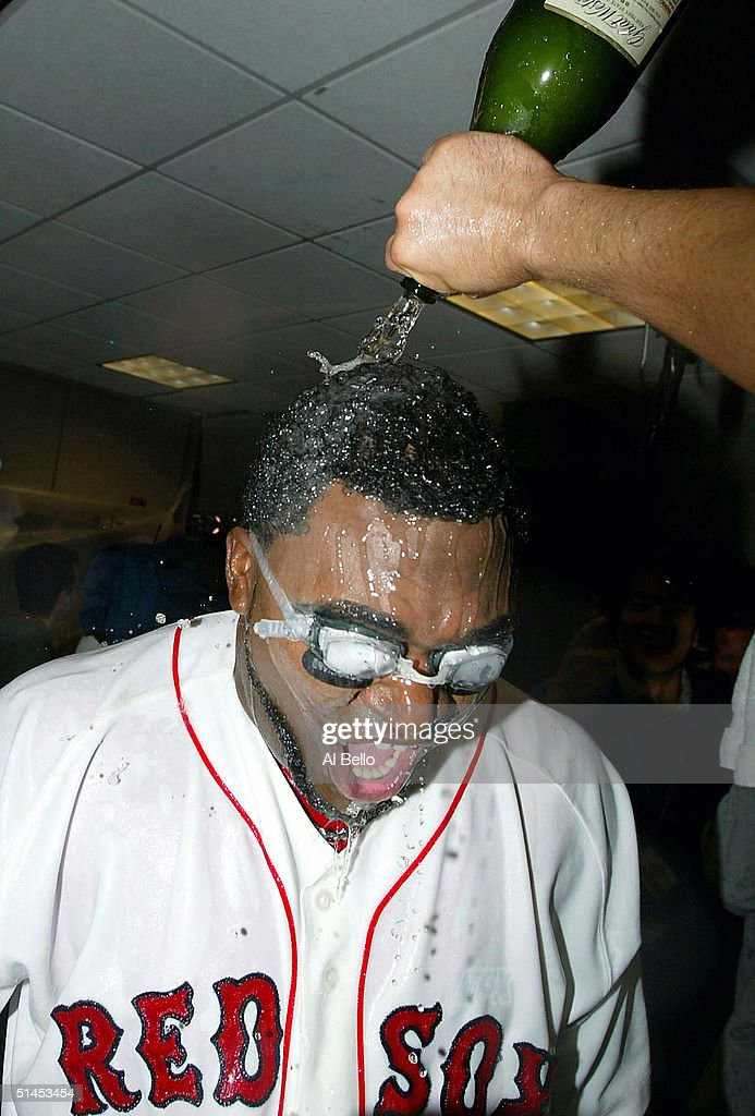 David Ortiz #34 of the Boston Red Sox celebrates with his teammates in the locker room after defeating the Anaheim Angels 8-6 in Game 3 of the American League Division Series October 8, 2004 at Fenway Park in Boston, Massachusetts. The Red Sox sweep the series best-of-five series.