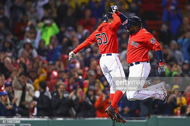David Ortiz of the Boston Red Sox celebrates with Mookie Betts after hitting a two run homer against the Toronto Blue Jays during the seventh inning...