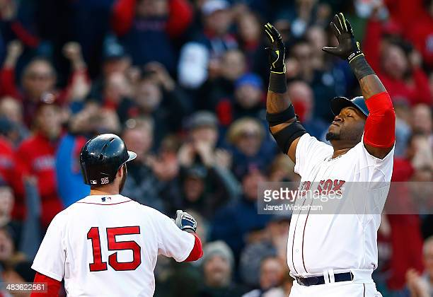 David Ortiz of the Boston Red Sox celebrates with teammate Dustin Pedroia after hitting a threerun home run in the 8th inning against the Texas...