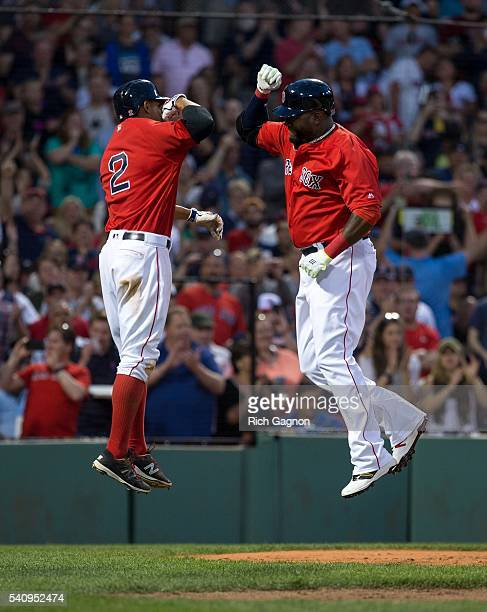 David Ortiz of the Boston Red Sox celebrates with teammate Xander Bogaerts after he hit a two-run home run during the fourth inning against the...