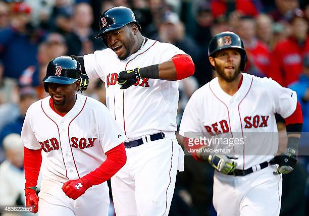 David Ortiz of the Boston Red Sox celebrates with teammates Jackie Bradley Jr #25 and Dustin Pedroia after hitting a threerun home run in the 8th...