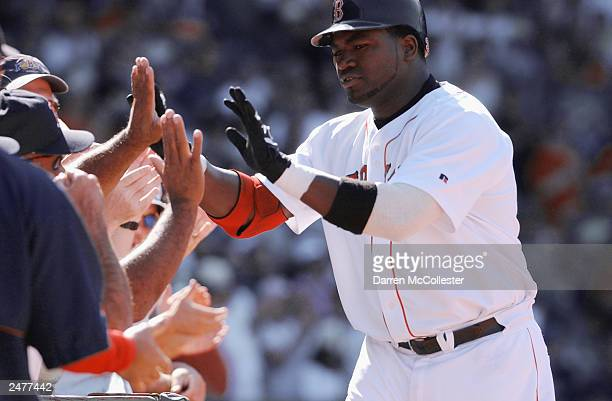 David Ortiz of the Boston Red Sox celebrates with the fans durig the MLB game against the Seattle Mariners on August 23 2003 at Fenway Park in Boston...