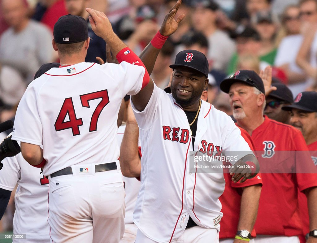 David Ortiz #34 of the Boston Red Sox celebrates with Travis Shaw #47 after a 4-6 win over the Toronto Blue Jays on June 4, 2016 at Fenway Park in Boston, Massachusetts.