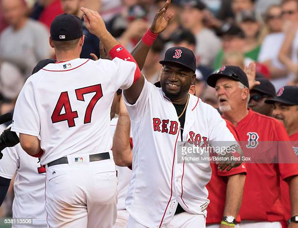 David Ortiz of the Boston Red Sox celebrates with Travis Shaw after a 46 win over the Toronto Blue Jays on June 4 2016 at Fenway Park in Boston...