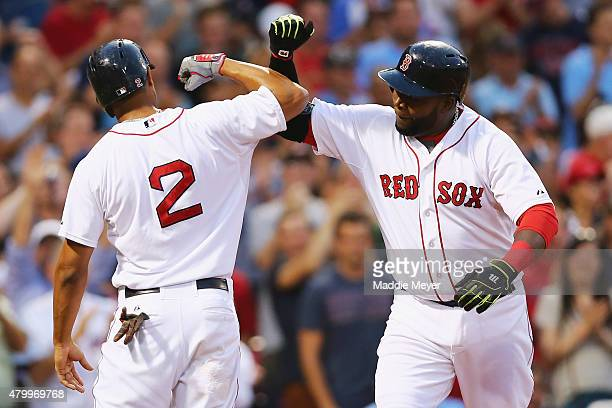 David Ortiz of the Boston Red Sox celebrates with Xander Bogaerts after hitting a two run homer during the third inning against the Miami Marlins at...