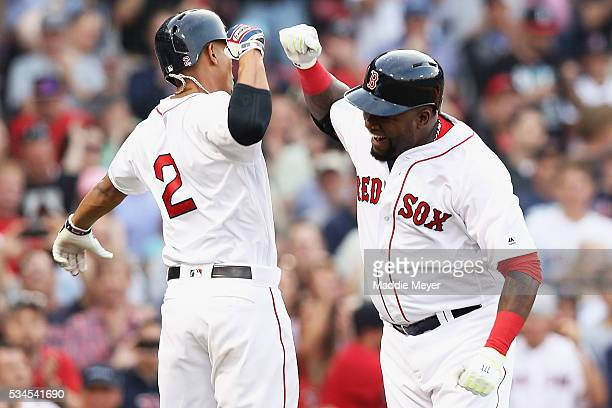 David Ortiz of the Boston Red Sox celebrates with Xander Bogaerts after hitting a home run against the Colorado Rockies during the first inning at...