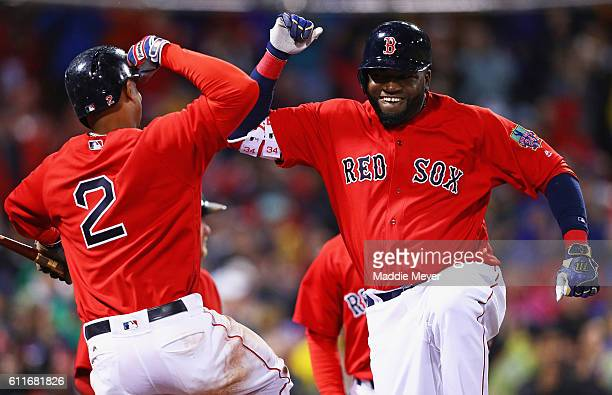 David Ortiz of the Boston Red Sox celebrates with Xander Bogaerts after hitting a two run homer against the Toronto Blue Jays during the seventh...