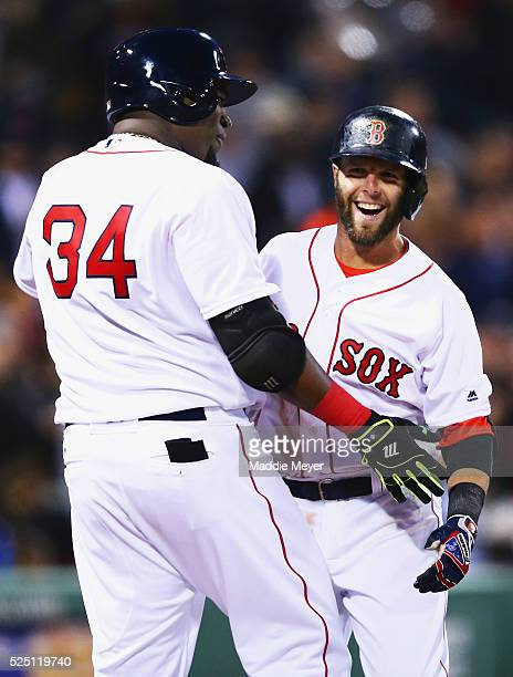 David Ortiz of the Boston Red Sox congratulates Dustin Pedroia after he hit a grand slam during the second inning against the Atlanta Braves on April...