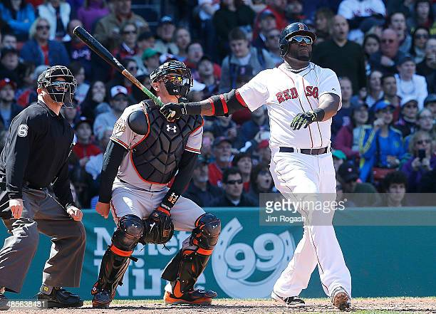 David Ortiz of the Boston Red Sox connects for a homerun in the fourth inning against the Baltimore Orioles at Fenway Park on April 19 2014 in Boston...