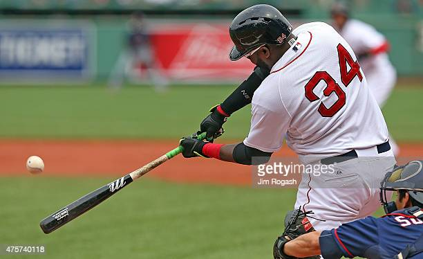 David Ortiz of the Boston Red Sox doubles in a run in the first inning against the Minnesota Twins during the first game of a doubleheader at Fenway...