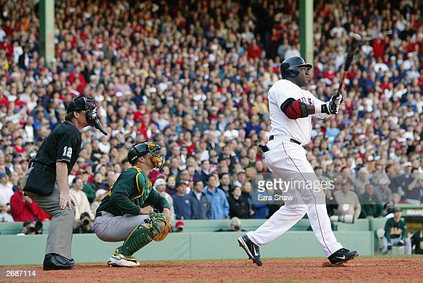 David Ortiz of the Boston Red Sox doubles in Nomar Garciaparra and Manny Ramirez to give the Red Sox a 54 lead over the Oakland Athletics in game...