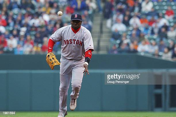 David Ortiz of the Boston Red Sox flips the ball to first base during the game against the Baltimore Orioles at Oriole Park at Camden Yards on April...