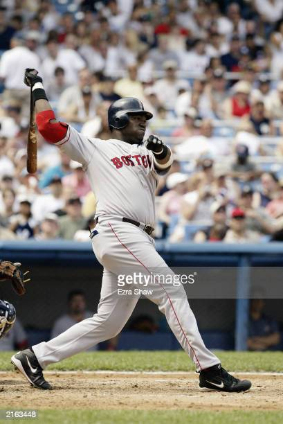 David Ortiz of the Boston Red Sox follows through on a swing against the New York Yankees on July 5 2003 at Yankee Stadium in Bronx New York The Red...