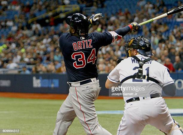 David Ortiz of the Boston Red Sox follows through on his two-run home run in the first inning of the game with the Tampa Bay Rays at Tropicana Field...