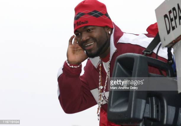David Ortiz of the Boston Red Sox gestures towards fans during the Rolling Rally parade held in honor of the Red Sox World Series victory in Boston...