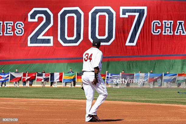 David Ortiz of the Boston Red Sox heads out on to the field to get his 2007 World Series Championship ring before the game the Detroit Tigers on...