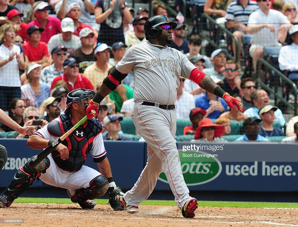 David Ortiz #34 of the Boston Red Sox hits a 5th inning three-run home run against the Atlanta Braves at Turner Field on May 26, 2014 in Atlanta, Georgia.