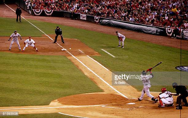 David Ortiz of the Boston Red Sox hits a double on a line drive to right fielder Larry Walker of the St Louis Cardinals during the third inning of...