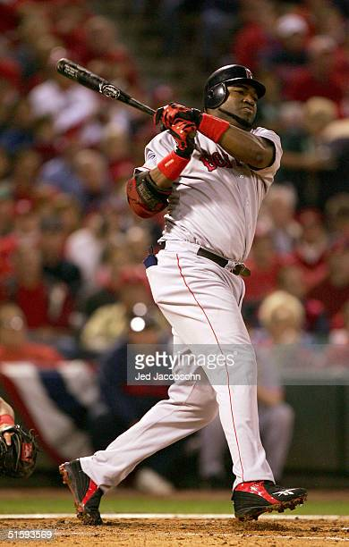 David Ortiz of the Boston Red Sox hits a double on a line drive to right fielder Larry Walker of the St. Louis Cardinals during the third inning of...