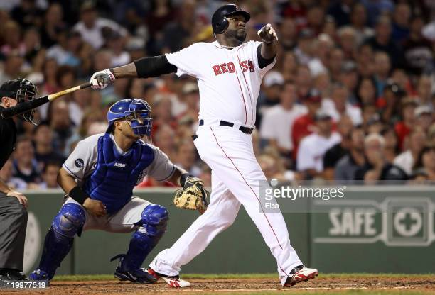 David Ortiz of the Boston Red Sox hits a grand slam in the fourth inning as Brayan Pena of the Kansas City Royals catches on July 27, 2011 at Fenway...