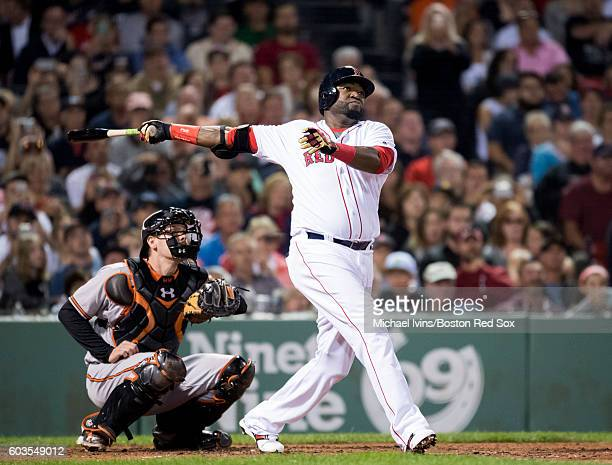 David Ortiz of the Boston Red Sox hits a home run against the Baltimore Orioles in the sixth inning on September 12 2016 at Fenway Park in Boston...