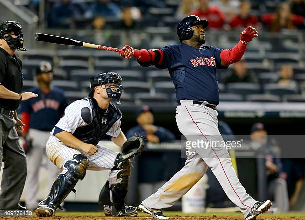 David Ortiz of the Boston Red Sox hits a solo home run in the 16th inning as Brian McCann of the New York Yankees defends on April 10 2015 at Yankee...