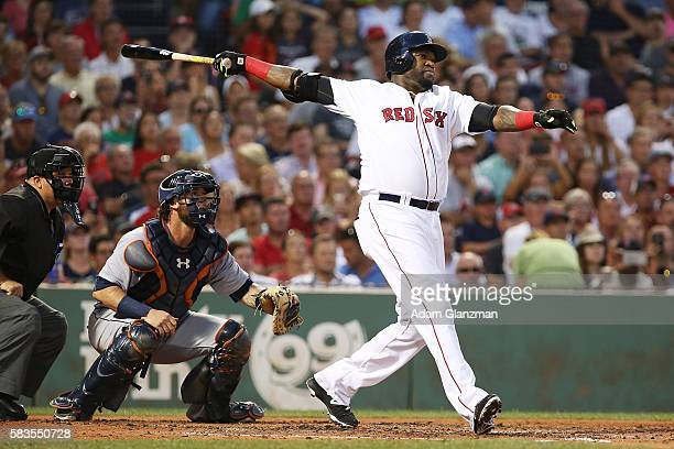 David Ortiz of the Boston Red Sox hits a three-run home run in the third inning during the game against the Detroit Tigers at Fenway Park on July 26,...