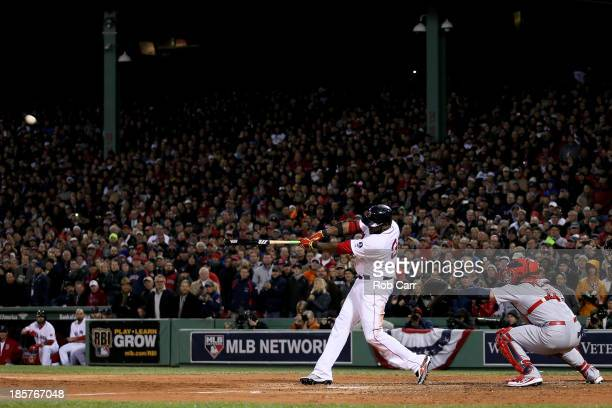 David Ortiz of the Boston Red Sox hits a two run home run in the sixth inning against the St Louis Cardinals during Game Two of the 2013 World Series...