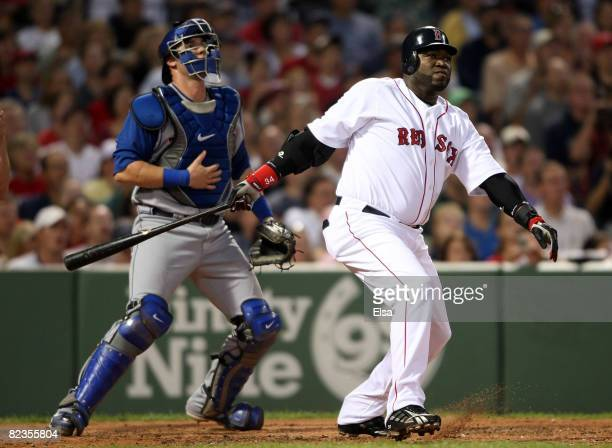 David Ortiz of the Boston Red Sox hits a two run homer in the second inning as Jarrod Saltalamacchia of the Texas Rangers defends on August 14 2008...