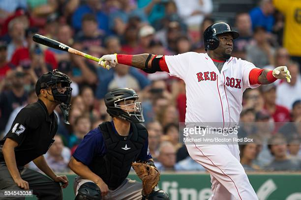 David Ortiz of the Boston Red Sox hits a tworun home run against the Colorado Rockies in the first inning on May 26 2016 at Fenway Park in Boston...